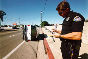Officer Flynn taking a 'CHP-555' non-injury collision report